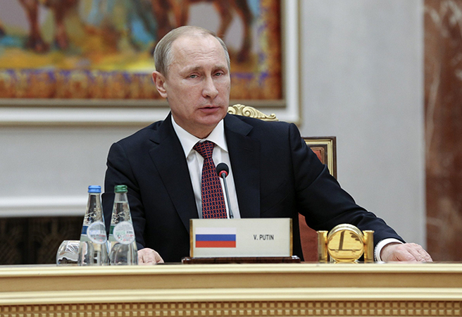 Russia's President Vladimir Putin takes part in peace talks on resolving the Ukrainian crisis in Minsk